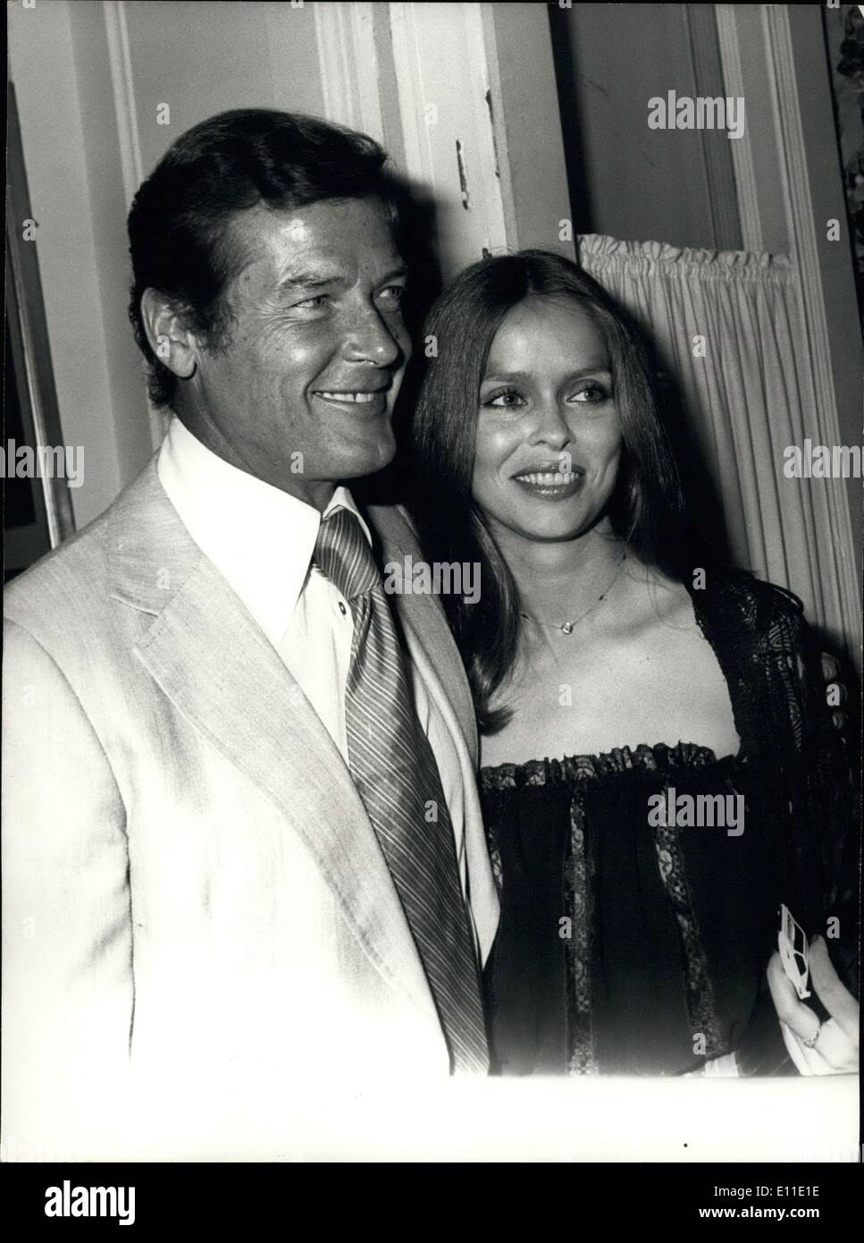 May 23, 1977 - Accompanied by his main partner, Barbara Bach, Roger Moore, whose alias is James Bond 007, came to Cannes where his latest movie ''The Spy Who Loved Me'' will be exclusively within the scope of the International Film Festival. Picture: - Stock Image