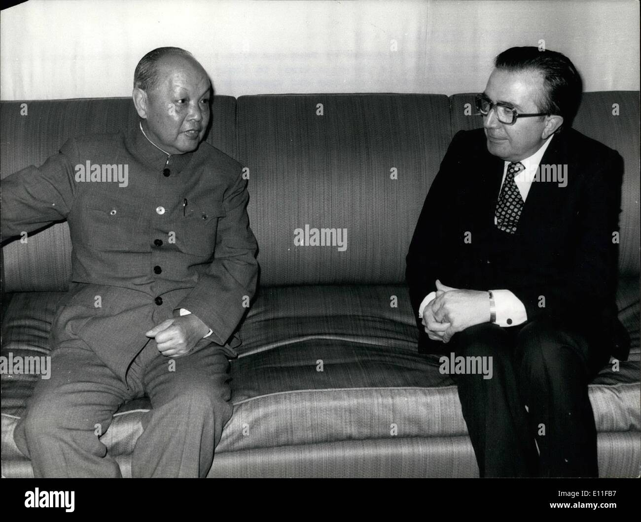 Oct. 10, 1977 - China's Postal Minister In Rome: Mr.Chung Fu-hsiang, the Minister of Post and Tell-communications of China, is paying a visit to Italy to inspect telecommunication systems and apparatus, as well as television installations. Photo shows Mr Chung Fu-hsiang in conversation with Italy's Premier Giulio Andreotti at the Palace Chigi in Rome. - Stock Image