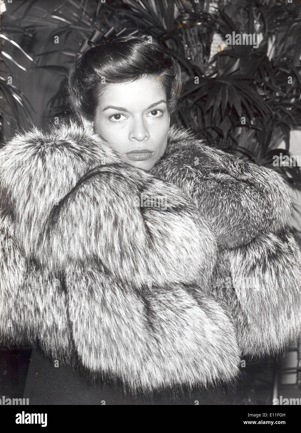 Model Bianca Jagger wearing fashion designs by Dior - Stock Image