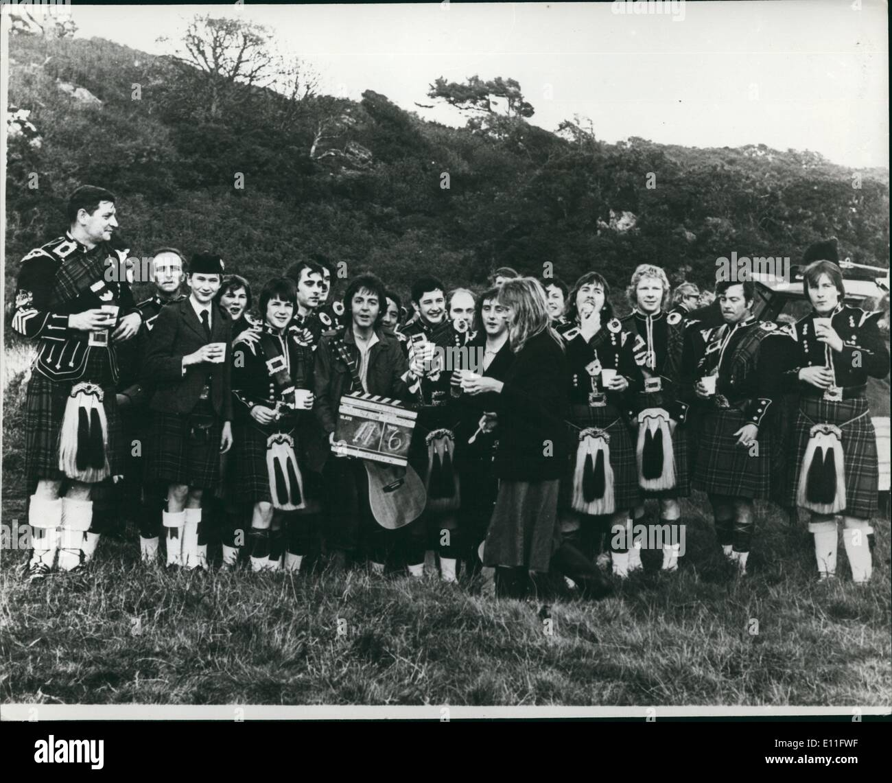 Nov. 11, 1977 - Wings Over Scotland: Paul McCartney's band, Wings, have recently been recording in Scotland, the ''Mull of Kintyre ''has been named after the headland on the West Coast of Scotland so of course it has a strong Scottish flavour. Photo shows Paul, Linda and Denny of Wings with the entire complement of the Cambeltown Pipe Band during filming for the promotional film for the ''Mull of Kintyre Stock Photo