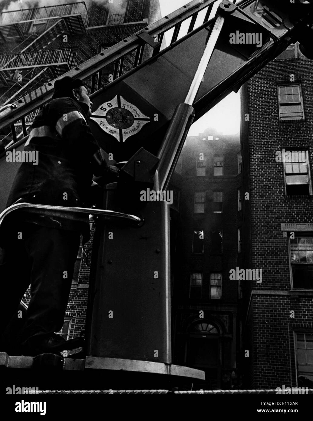 Jan 15, 1978; New York, NY, USA; New York Firefighters of 58th precinct on Tremont Ave. raise the ladder in West Bronx.. - Stock Image