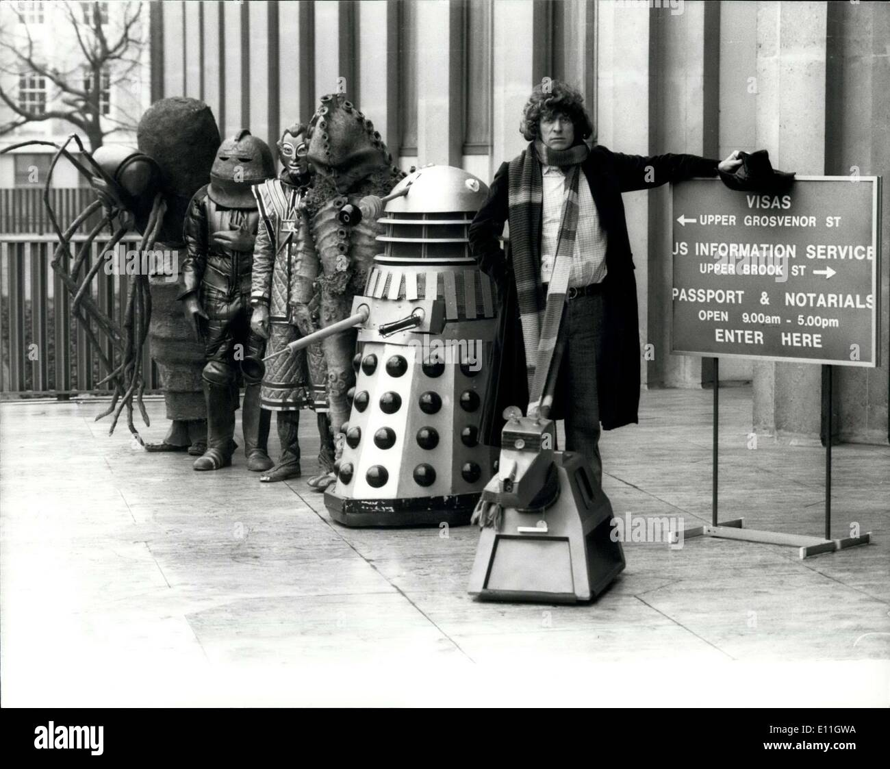 Feb. 14, 1978 - Dr. WHO Monsters At The American Embassy. Queueing up for their American visas at their American Embassy in Grosvenor Square today are Dr. WHO (Tom Baker) and some of the Monsters he has encountered through time and space. BBC Enterprisers, the International selling Arm of the Corporation, is making a big sales bid with Dr WHO and other BBC shows at this year's NATPE (National Association Of Television Programme Executives), America's biggest television programme market, being held in Los Angeles from march 3rd, with Tom is the faithful Robot K-9 Plub Sontaran, Wirrn, Zygon, - Stock Image