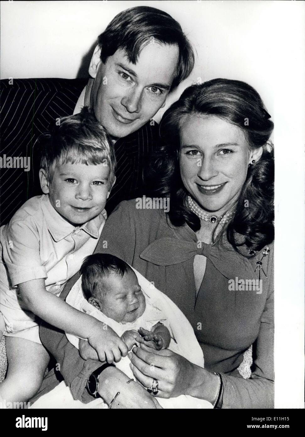 Dec. 21, 1977 - December 21st 1977 First pictures of the Duke and Duchess of Gloucester's new baby. The latest member of the Royal Family is Lady Davina Elizabeth Alice Benedikte Windsor, born four days after Princess Anne's son, is the daughter of the Duke and Duchess of Gloucester. Lady Davina weighed into the world at 7lb 11oz. Photo Shows: The Duke and Duchess of Gloucester posing for a family portrait at Kensington Palace with their children, the Earl of Ulster, 3, and four-week-old Lady Davina. - Stock Image
