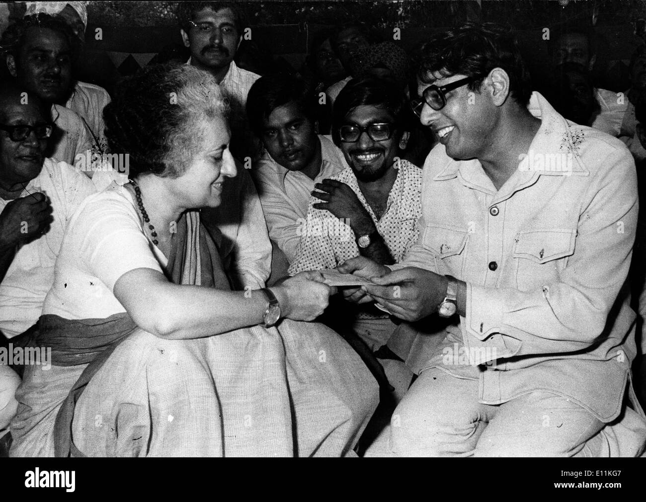 INDIRA GANDHI, Prime Minister of India is given a check by a Congress worker for flood relief - Stock Image