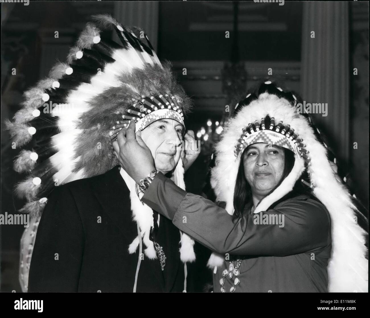 Feb. 02, 1979 - Lord Mayor Presented With Indian Head Dress: At the Mansion House today the Lord Mayor Sir Kenneth Cork, received Chief Joe Sierra, of the Tigua Indian Tribe, and is also the Assistant to the Mayo of El Paso for Indian Affairs. He is with a party of 50 strong delegation of representatives from the tourist industry, promoting travel to Texas under the suspicious of the US Travel Service. Photo Shows Chief Joe Sierra, is seen placing the headdress on the Lord Mayor Sir Kenneth Cork during his visit to the Mansion House today. - Stock Image