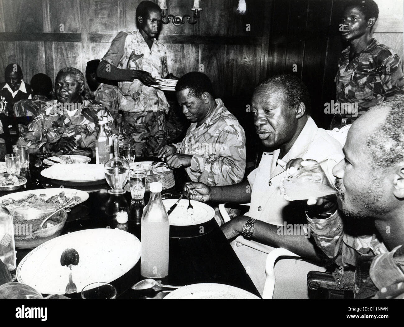Apr. 23, 1979 - Uganda - President of Uganda YUSUF LULE eats his first meal as head of state with Defense Minister of Tanzania, - Stock Image