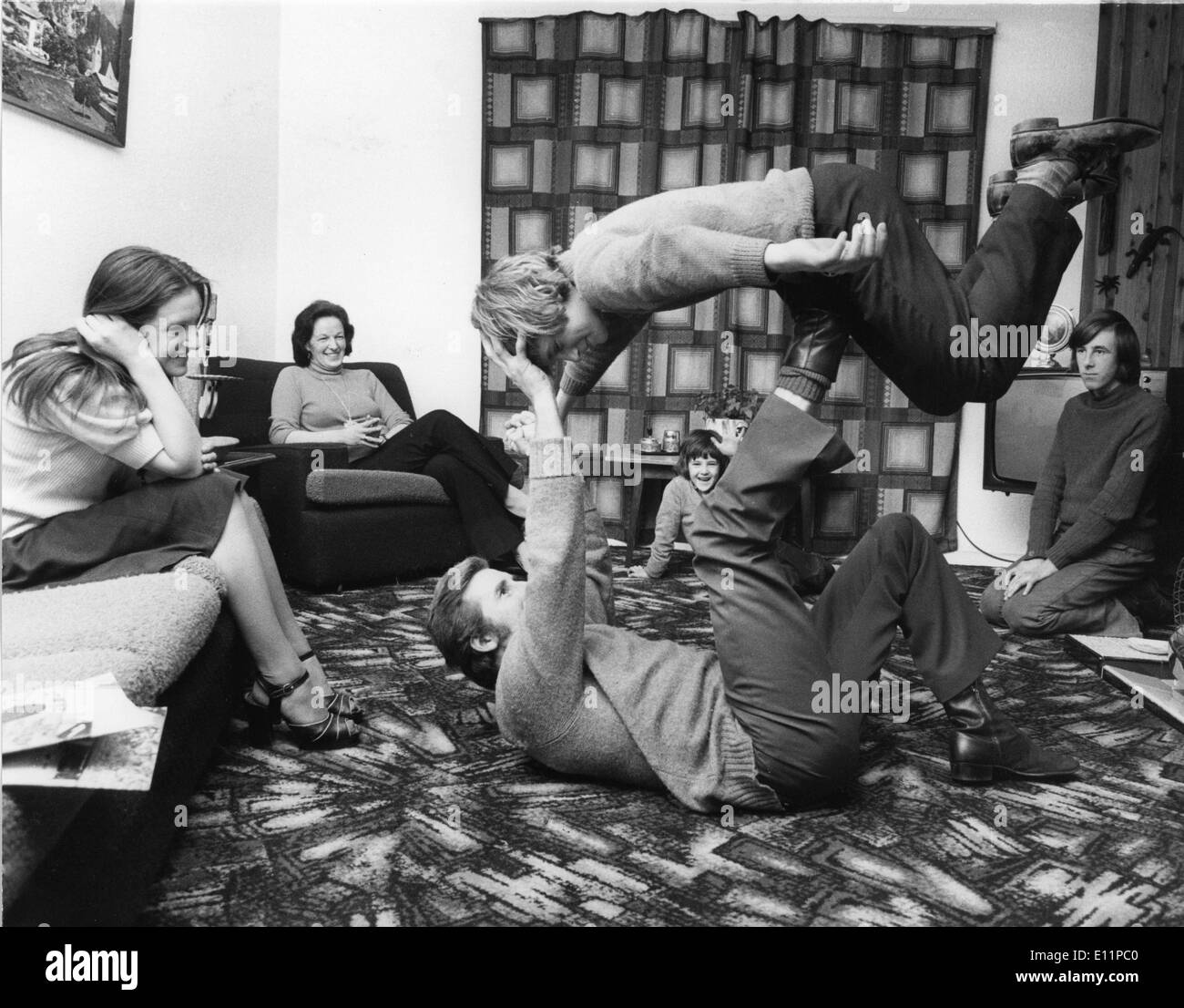 May 23, 1979 - Sunderland - Stunt doubles TERRY and DENNIS CAMSEY perform a trick for their family in their homes living room. - Stock Image