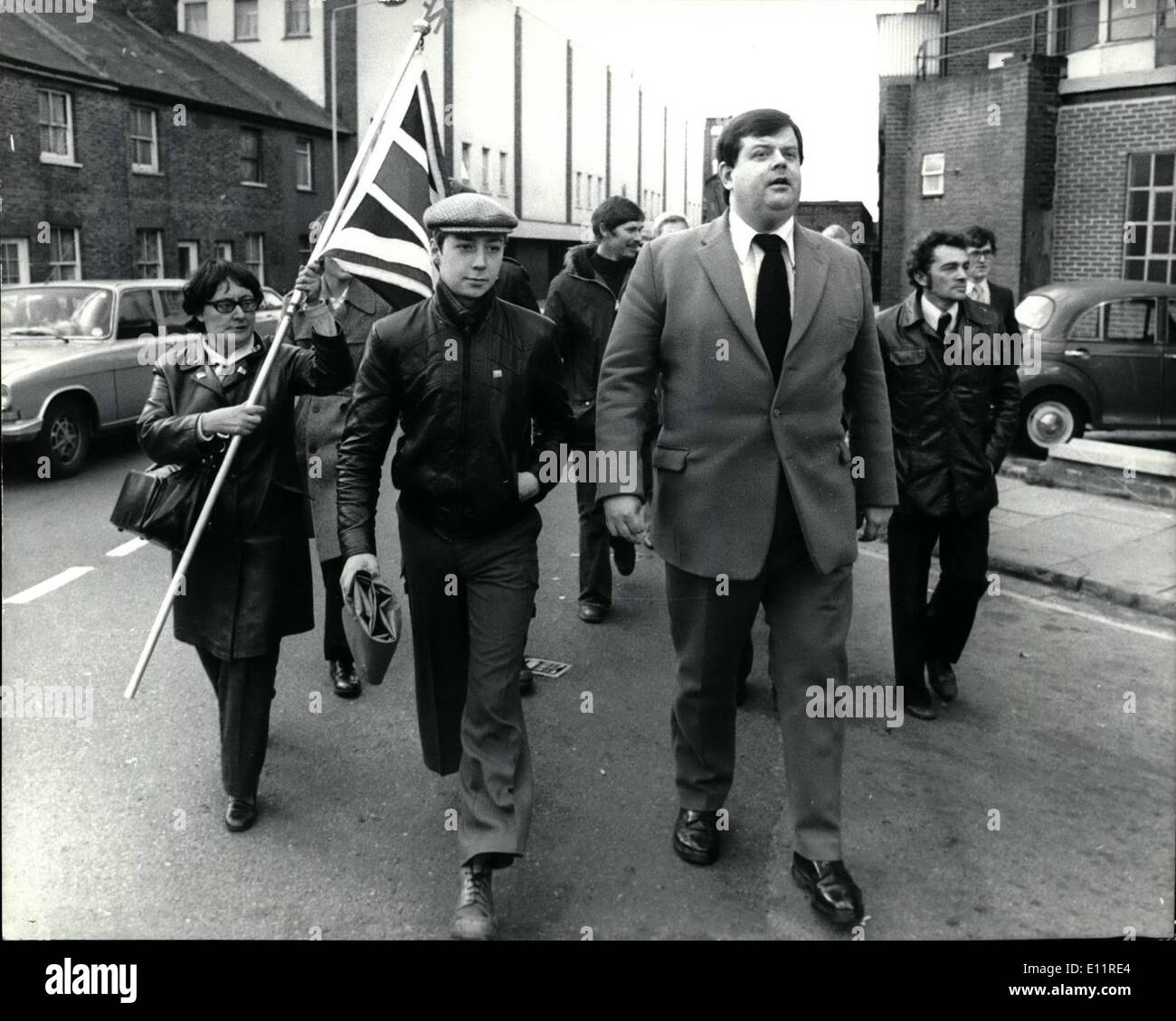 Oct. 10, 1979 - National Front Leader Martin Webster Gets A Six Month Suspended Jail Sentence: Martin Webster, the National Front leader was given a six-month suspended sentence at Kingston Crown Court yesterday for inciting racial hatred. He was also fined 150 and ordered to pay 530 costs. He denied publishing abusive material likely to incite racial hatred. As he left the court he said: ''I will continue to campaign against colored immigration''. Photo shows Martin Webster seen leaving Kingston Crown Court with some of his followers. Stock Photo