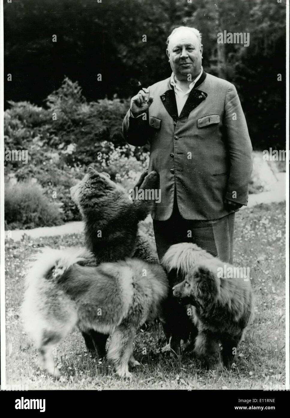 Jan. 02, 1980 - 30th day of death of Emil Jannings:30 years ago, at January 2nd 1950, died, in Strobl at the Lake Wolfgang/Austria, Emil Jannings (photo shows) him with his dogs on his holding in Strobl) one of the most well known German character actors from stage and film. Born at July 26th 1884 in Rorschach/Switzerland he was first cabin boy and then he went as a volunteer to the city-theatre of Goerlitz/West-Germany. At the same time he got first film-offers from well known director Ernst Lubitsch - Stock Image