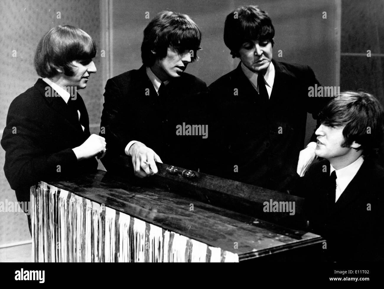 The Beatles RINGO STARR, GEORGE HARRISON, PAUL McCARTNEY, JOHN LENNON during recording session - Stock Image