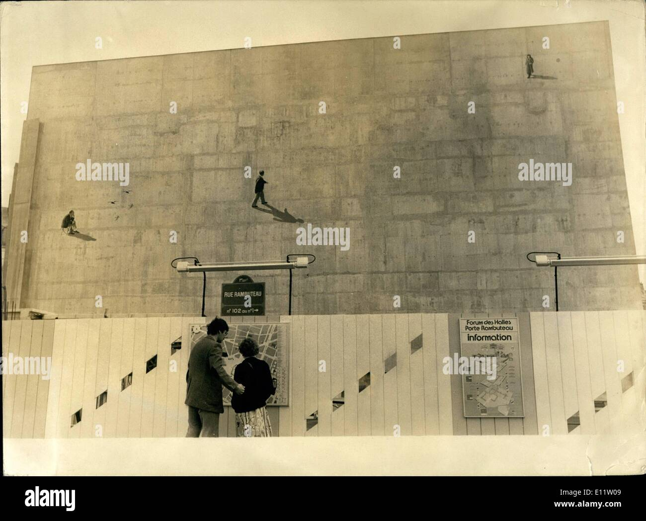 Jul. 07, 1980 - Fabio Rieti, an Italian painter, just added a third person to the wall of Beton at the Foreum des Halles: a sitting man, his self-portrait that we will see alongside two other people, a man who is walking and a woman. Paris's Lido Cabaret Presets Louis X - Stock Image