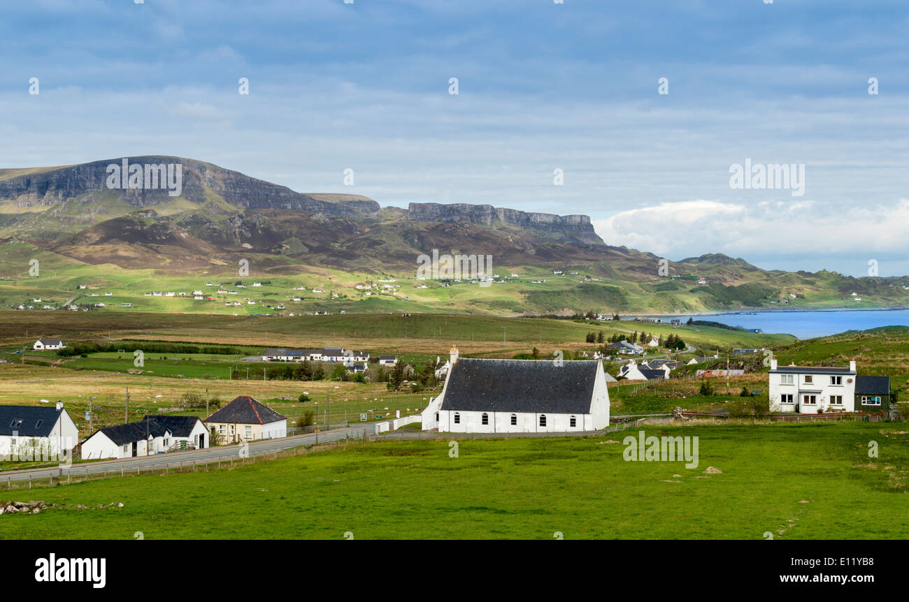 STAFFIN VILLAGE AND RANGE OF HILLS THE TROTTERNISH RIDGE BEHIND THE HOUSES ON THE ISLE OF SKYE SCOTLAND Stock Photo