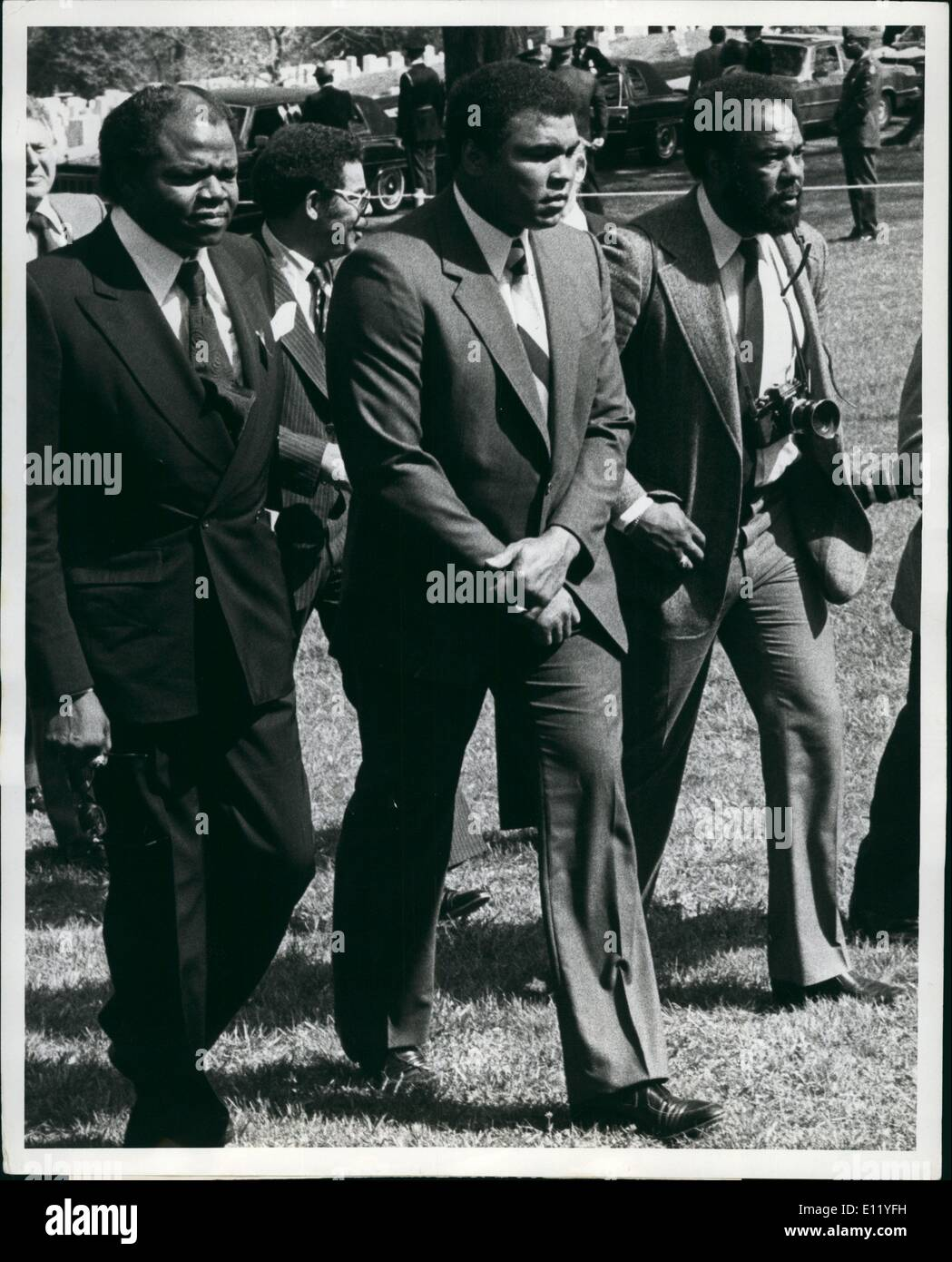 Apr. 04, 1981 - Consolidated news pictures.. Ali attends Lewis Funeral Arlington, Cemetery VA. 4/21/81.. Former heavyweight boxing chapion Muhammad Ali (Center) is shown at Arlington cemetery today as he attended the Joe Lewis Funeral Ceremony. Ali, Joe Walcott, Billy Vonn and Jow Frazier were some of the celebrities that attended the funeral. - Stock Image