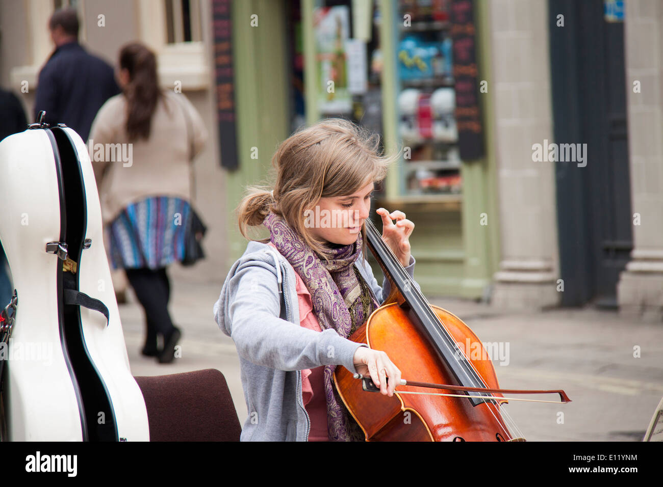 A young lady plays cello to raise money for charity in the centre of York, England. - Stock Image