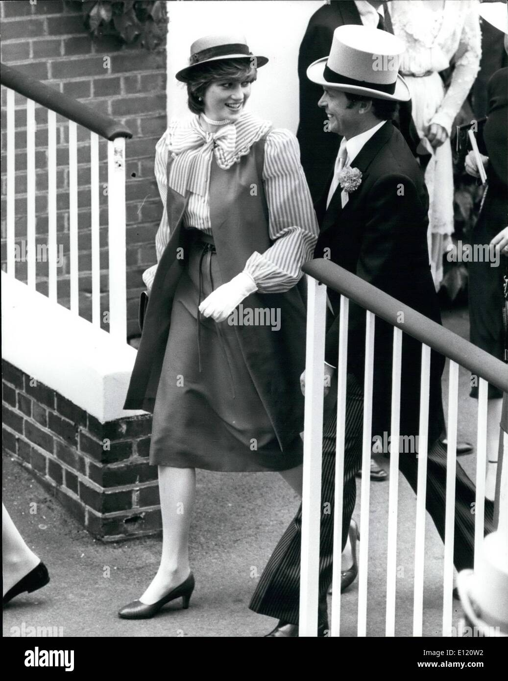 Jun. 06, 1981 - Lady Diana the Toast of Ladies' Day at Ascot Lady Diana Spencer was the toast of Ladies' Day at Royal Ascot yesterday. She is seen walking with her detective, Inspector Graham White, wearing a red straw boater and red and white candy striped blouse. - Stock Image