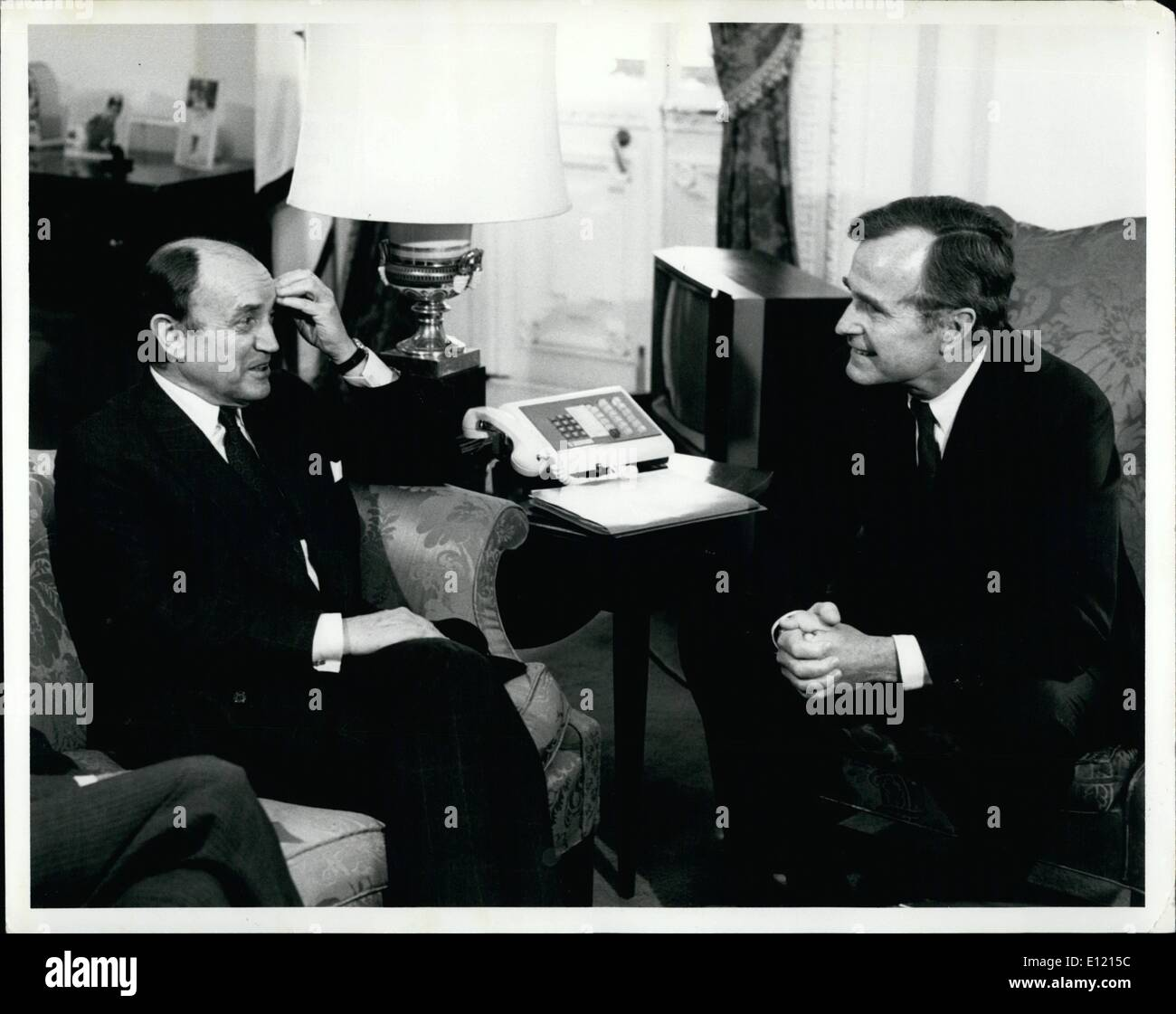 Jun. 06, 1981 - Vice President George Bush (right) is shown in his office of the Executive office Building next to the White House today as he met with visiting French Foreign Minister Claude Cheysson (left). Earlier Cheysson met with President Reagan at the White House and will hold other meeting with Secretary of State Alexander Haig at The State Department. - Stock Image
