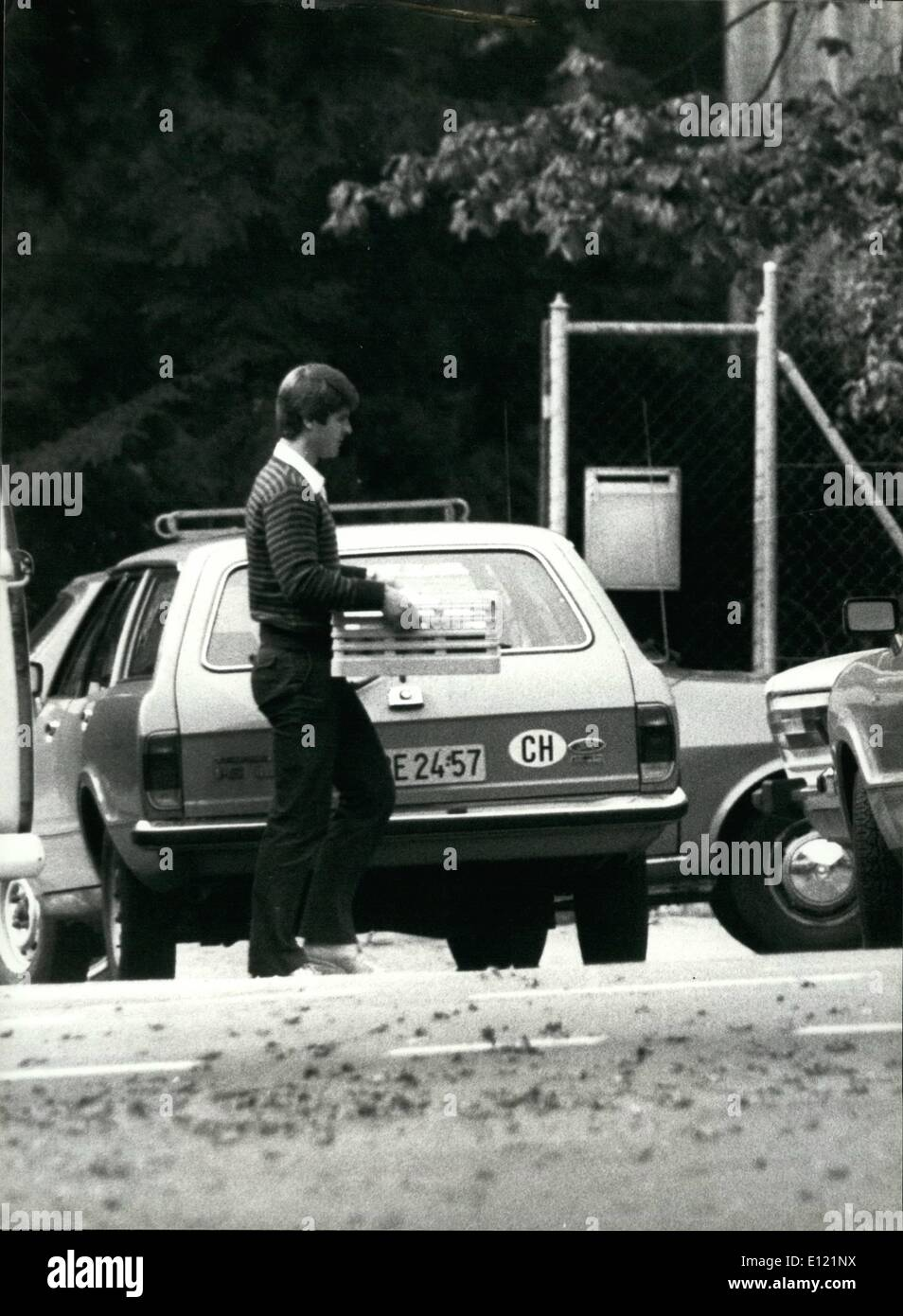 Sep. 09, 1982 - The beginning of the end... The occupation of the Polish Embassy in Berne, Switzerland, was ended Thursday morning, Sep. 9, by Swiss police in a short assault. OPS: Start of the police assault: Unidentified man brings breakfast suitcase requested by the occupiers, to the outdoor of the occupied building. Hidden in the suitcase is a bomb with special gas, sound and light effects. The door was blown up shortly after and the four occupiers arrested unhurt, as well as the five remaining hostages were freed unhurt. - Stock Image