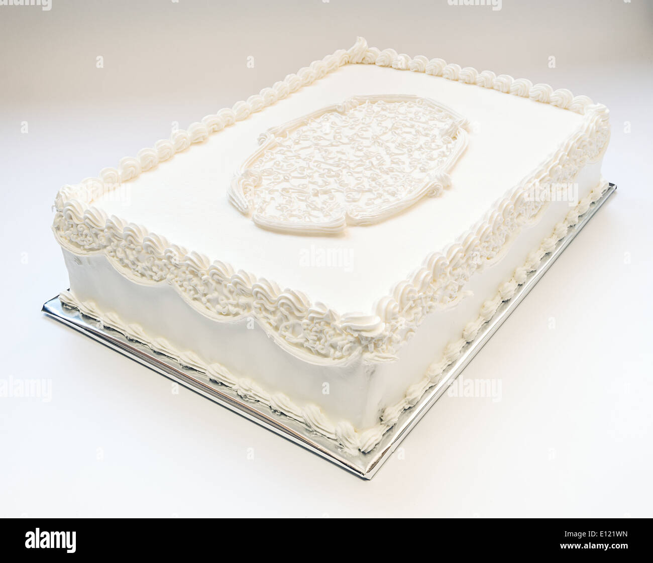 Simple Wedding Cake All In White On Gray Background Ornamented On