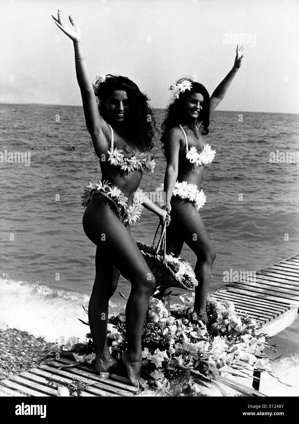 Jul 08, 1985; Nice, FRANCE; Models VALERIE and JOANNE wearing bathing suits made out of flowers in the French Riviera.. - Stock Image