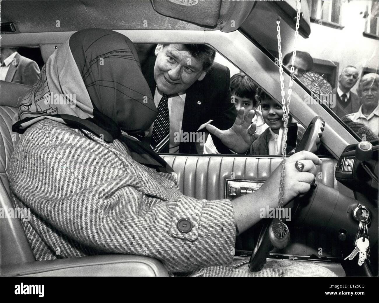 Oct. 10, 1986 - She drove the car blindfolded: The artiste Athene Radar is seen in her car with blondfolded eyes starting to a car trip of one km without seeing anything. She drove the car from the Market place to the Rumelinsplace in Basel and back followed by her father in another car who helped her with magic forces. - Stock Image