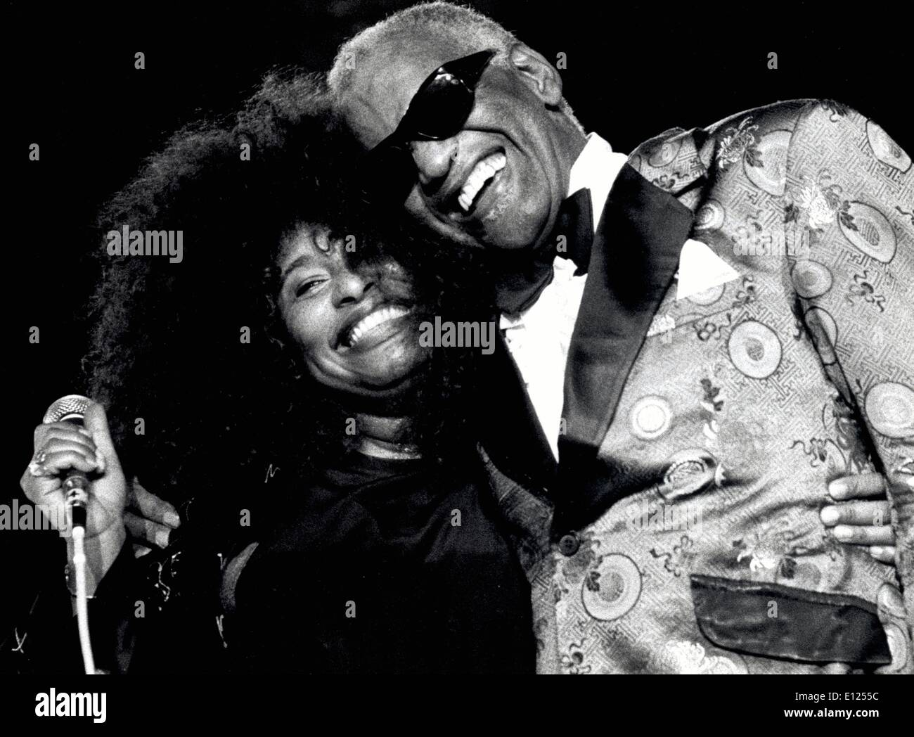 July 18, 1991 - Montreal, Canada - Grammy Winning Singer Ray Charles Robinson died at age 73 surrounded by family in Beverly Hills, California on June 10, 2004. The music legend won a total of 12 Grammy Awards and had dazzled fans since the late 1950s. Charles overcame a tough childhood in poverty, blinded at 7-years-old and an orphan at 15, to become of the world's extraordinary musicians in a range of musical genres. PICTURED: Jazz legend RAY CHARLES hugs singer CHAKA KHAN after her performance at the 1991 Montreux Jazz Festival. - Stock Image