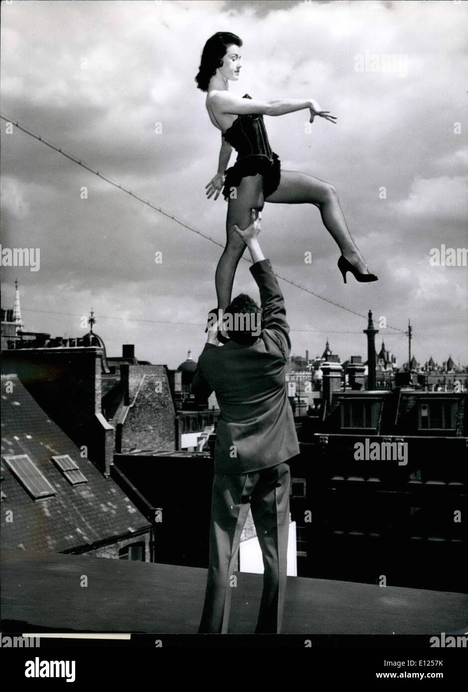 Mar. 03, 1987 - Another attractive statue is added to the London skyline as pretty Marian Morris is lifted aloft by one of her partners. She looks as if she is about to step onto Nelson's Column. - Stock Image
