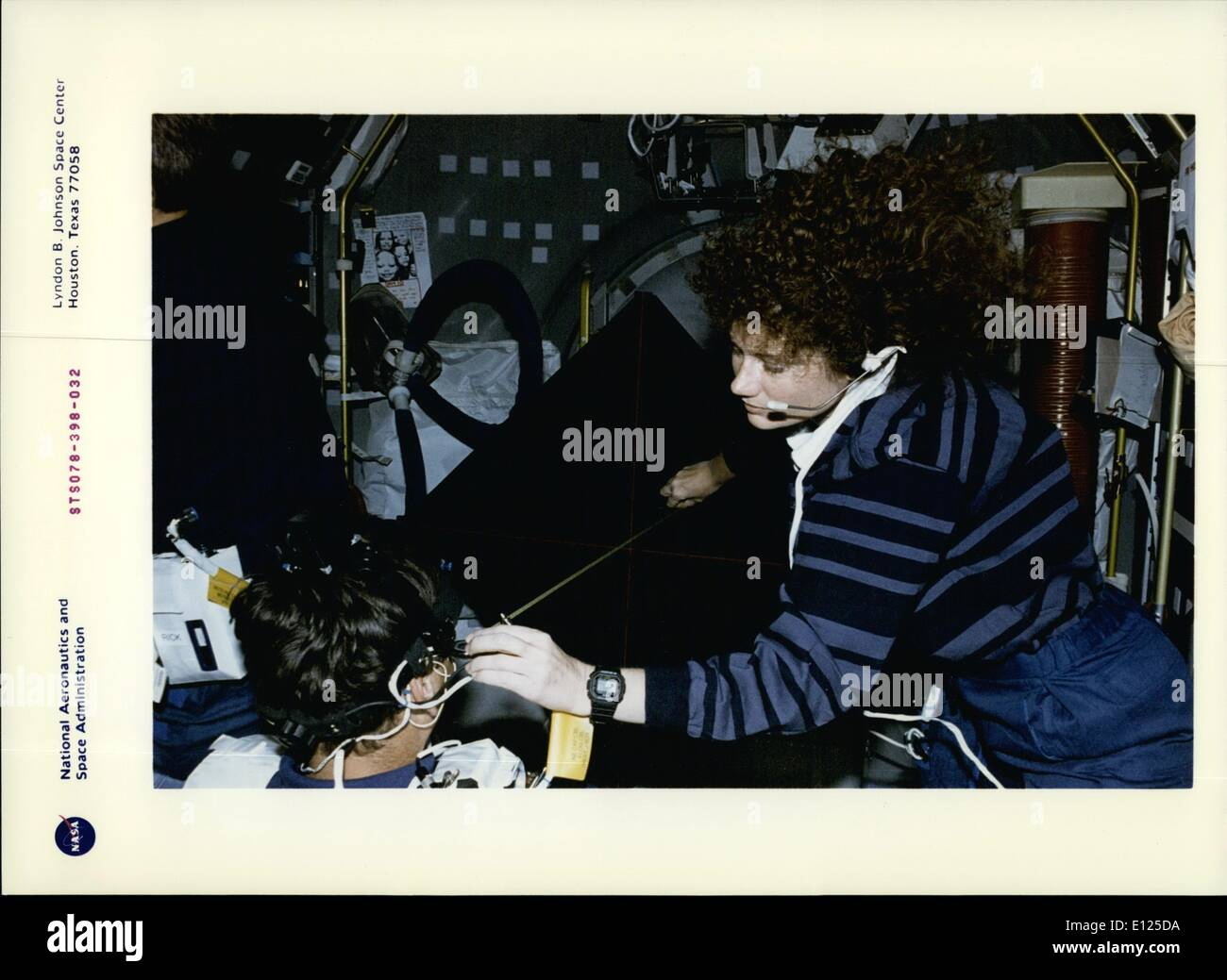 Jun. 06, 1996 - Astronaut Susan J.Helms, payload commander, measures the distance between Jean-Jacques Favier's head and the Luminous torque, used for the Canal and Otolith interaction study (Cois) on the Life and Microgravity Spacelab (Lms-1) mission. Favier, representing the French Space Agency (Cnes), is one of two international payload specialists on the almost-17 day flight. This view shows the Voluntary head Movement (Vhm) segment of the Experiment. The Vhm is meant to characterize how the coordination of head of head and eye movement changes as a result of spaceflight - Stock Image