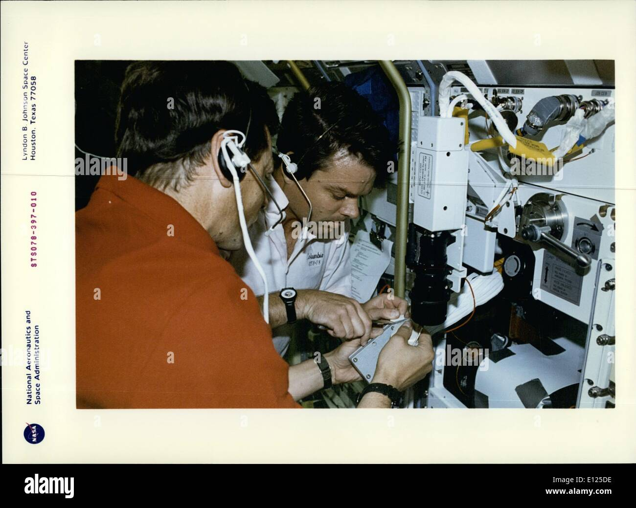 Jun. 06, 1996 - Johnson Space Center, Houston, Texas: STS-78 On Board View: Payload specialist Jean-Jacques Favier, reepresentating the French Space Agency (CNES), and astronaut Kevin R. Kregel, pilot, perform a succesful Inflight Maintence (IFM) on the Bubble Drop Particke Unit (BDPU). The lFM technique was performed initially on the ground at the Marshall Space Flight Center (MSFC) by altemate payload specialist pedro Duque o the European Space Agency (ESA), with the procedure being recorded on video and uplinked to the crew of the Space Shuttle Columbia to aid in the repair. - Stock Image
