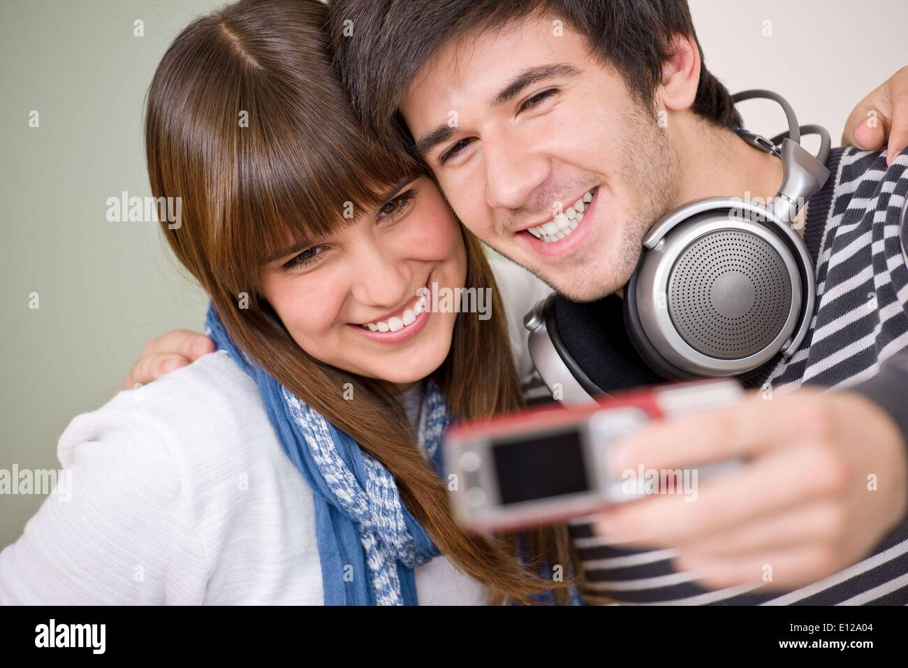 Apr. 17, 2010 - April 17, 2010 - Students - happy smiling teenage couple taking photo with camera - Stock Image