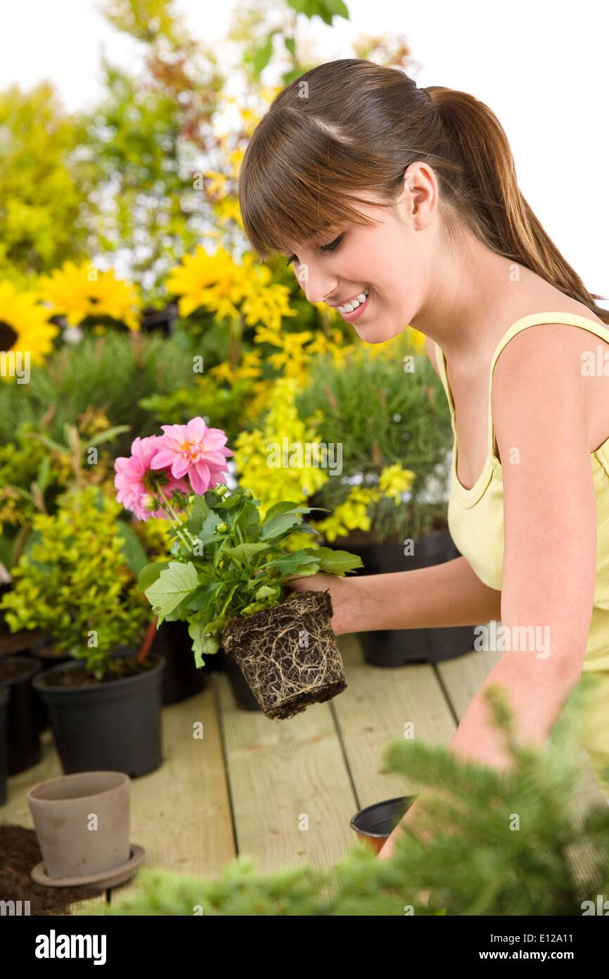 May 01, 2010 - May 1, 2010 - Gardening - smiling woman holding flower pot on white background - Stock Image