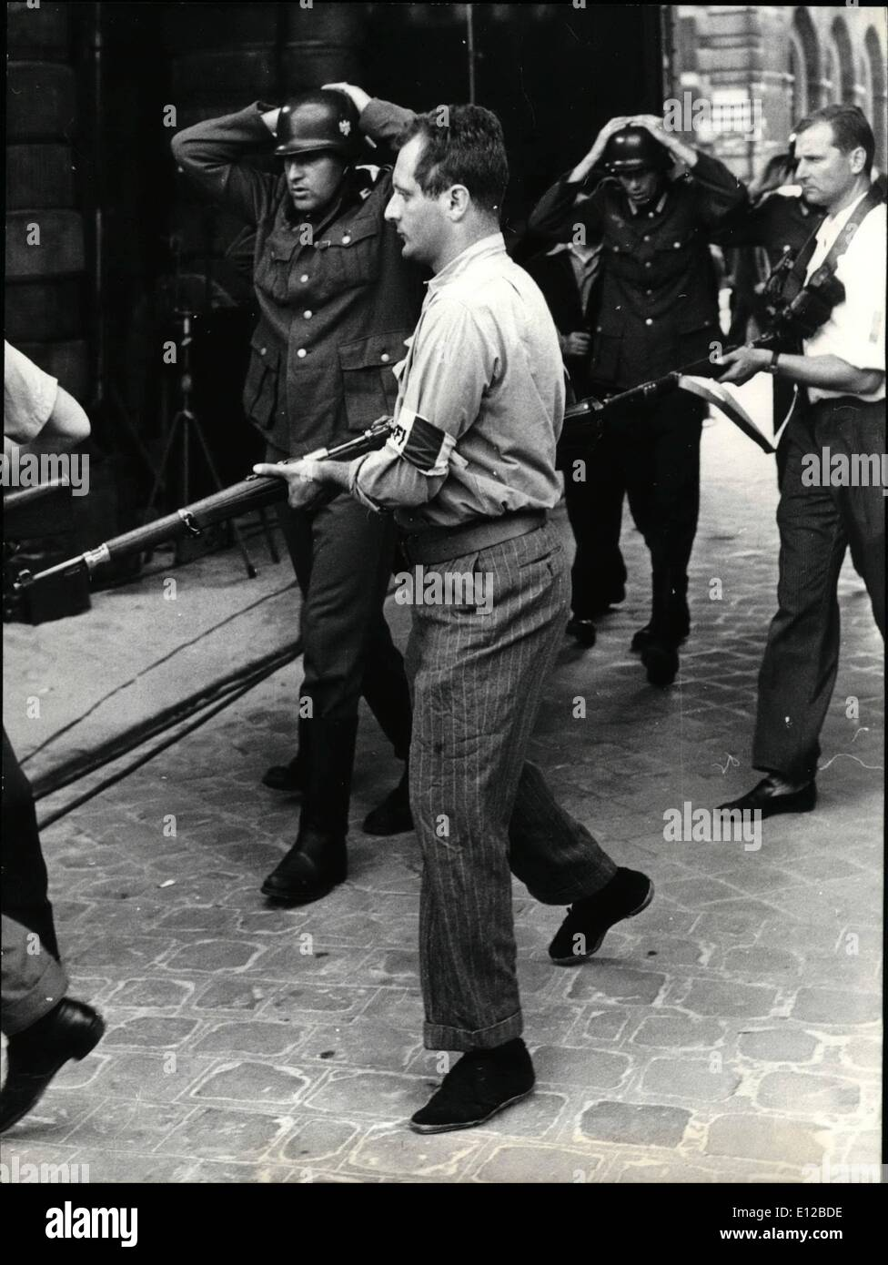 Dec. 09, 2011 - New Cinema Version of Liberation of Paris: A film reviving the glorious days of the liberation of Paris in August 1945 is now in the making. Photo shows German Soldiers surrounding TC armed resistants. - Stock Image