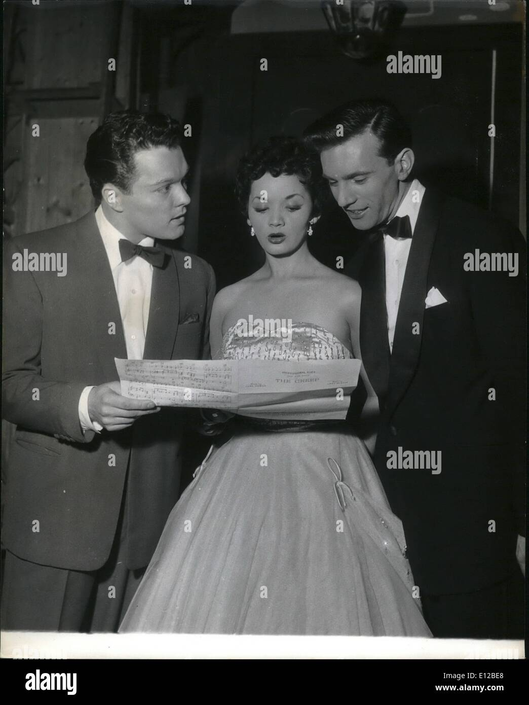 Dec. 09, 2011 - Before the 10th performance of the heath's sting sessions at the palladium vocalist lats Rosa checks a script with singer Dickie valentine (left) and Dennis lotion, another singer. - Stock Image