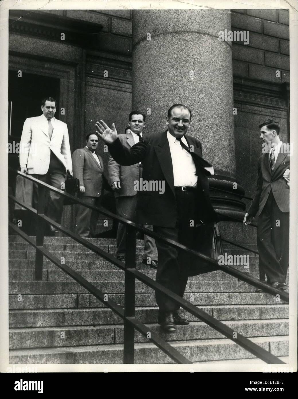 Dec. 09, 2011 - Exclusive.Senator McCarthy Investigates Reds in New York. Photo Shows Senator McCarthy leaving the New York Federal court after holding a session of Investigation . following him is Robert Jones (Assistant to Senator Potter , Republican Representative for Michigan) and Harold Rain ville (Assistant to Senator Dirk sen). top of steps. - Stock Image