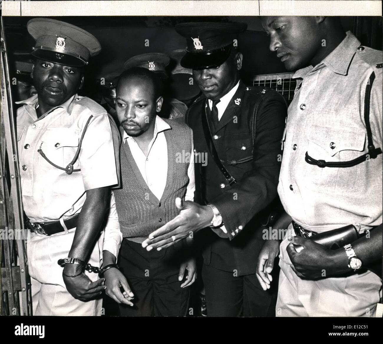 Dec. 12, 2011 - Nahashon Isaac Njenga Njorogo, the man charged for the murder of Tom Mboya on July 5th in a Nairobi main street. The preliminary inquiry lasting seven days came to an end today in the Nairobi court. The trial will now go to the High Courts. During the preliminary inquiry 64 witnesses were brought to court. The picture shows Njoroge being escorted to the court in Nairobi today (Monday August 18th) - Stock Image