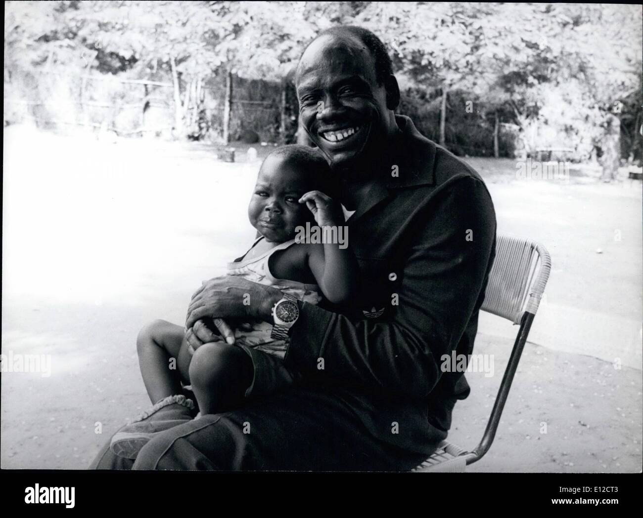 Dec. 16, 2011 - southern Sudan : General Mustafa Adrisi, former Vice President and Defence Minister in Idi Amin's regime pictures here with one of his 36 children now living in Southern Sudan. - Stock Image