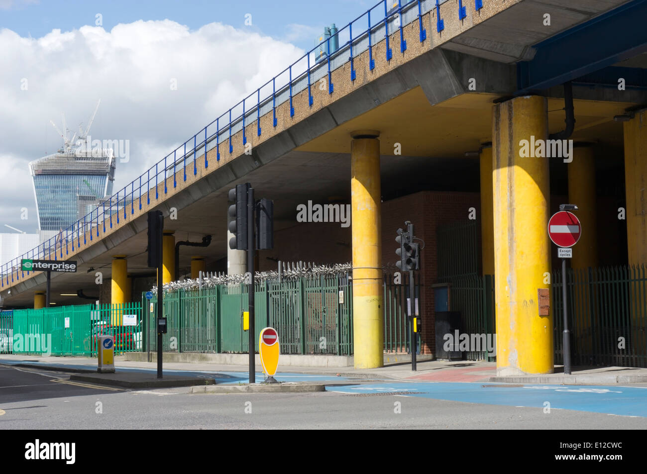 Elevated section of the Docklands Light Railway next to Cable Street in Tower Hamlets, East London. - Stock Image