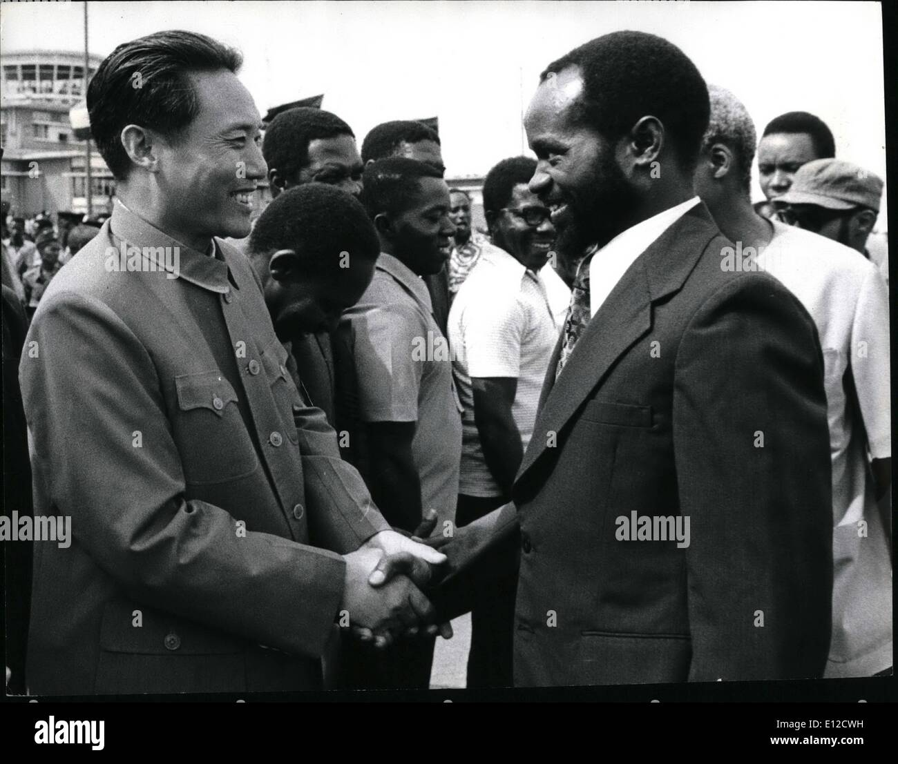Dec. 12, 2011 - At his farewell at Dar es Salaam Airport, Sahora Machel shakes hands warmly with a senior Chinese Embassy official. The Chinese are good friends of the Tanzanians, and have also provided considerable material and moral support to the anti colonial war waged by Machel and Frelimo. Will Chinese influence on independent Mozambique be important? Machel is a Marxist himself, and the post independence policies of his country, insofar as they have been revealed, will be strongly Socialist in pattern - Stock Image