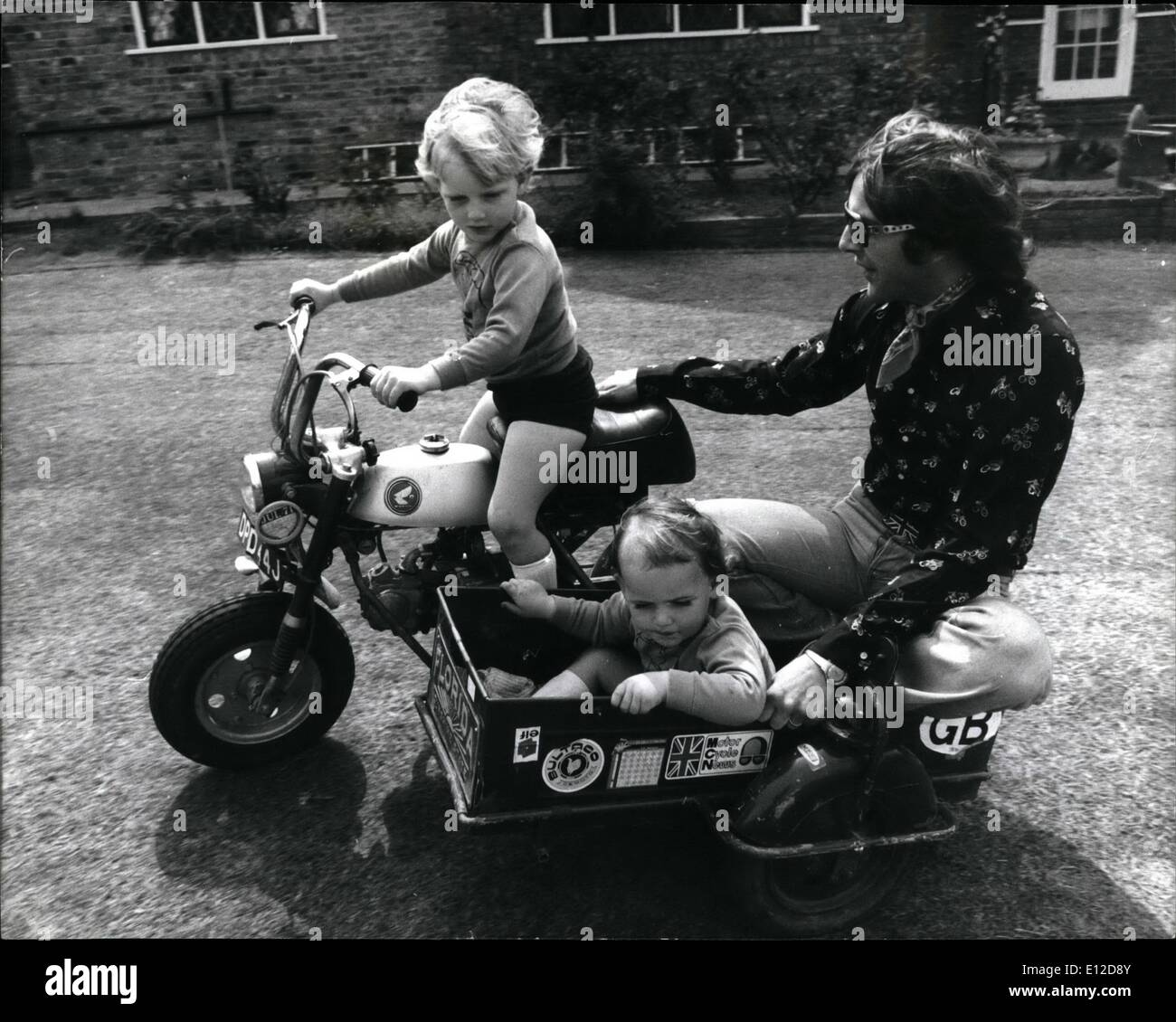 Dec. 15, 2011 - Phil Read's Son - the 4 year old motor-bike fiend.: Pip, the on of Motor-Cycle World Champion Phil Read simply can't wait until his legs are long enough to reach the pedals. So dad had to get a special mini version of his own 500 c.c. machine made at the MV factory in Milan. Pip's bike is a power packed 48 c.c. machine with a top speed of 15 m.p.h. - perfect for the 'Garden Circuit' at the Read's Oxshott home in Surrey. The bike is a prefect replica of Dad's bike, it cost 180 and Phil say's; ''It makes a great little ride - Stock Image