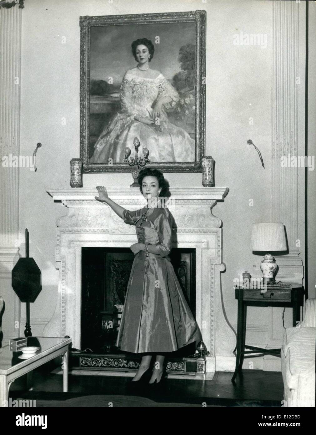 Dec. 19, 2011 - Lady Mary Baillie-Hamilton photographed in the drawing room of her London home in Tite Street, Chelsea. Over the mantelpiece is a portrait if her mother, the Countess of Haddington. She Will Attend The Queen On Coronation Day: Six beautiful girls whose ages range from 17 to 83 have been chosen by the Queen to be her Maids of Honour at the Coronation Service. Queen Victoria set the precedent when she was crowned. Maids of Honour instead of the usual Pages carried her train. The girls are being trained by Mary, Duchess of Devonshire, Mistress of the Robes to the Queen - Stock Image