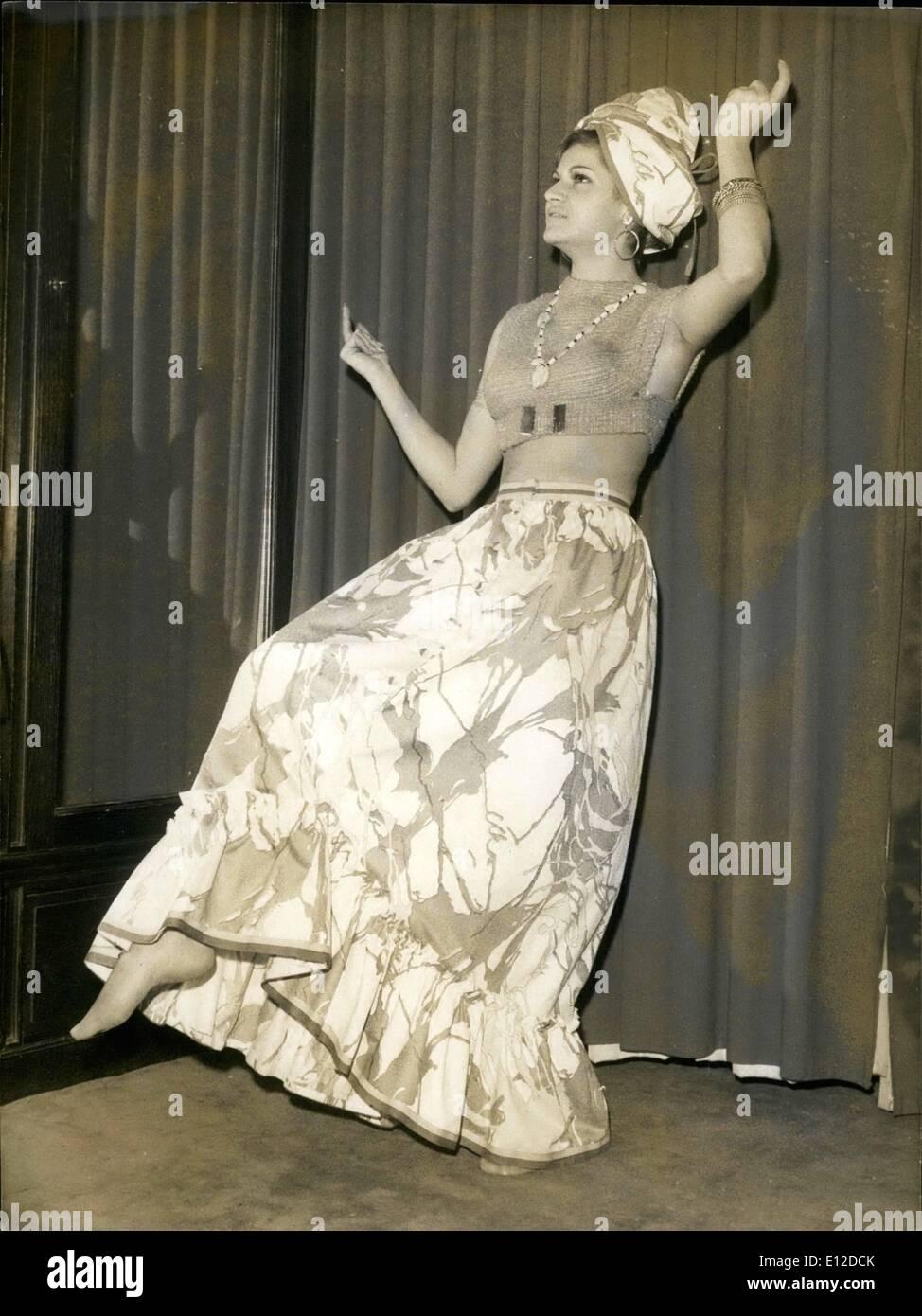 Dec. 19, 2011 - NPM-''Creole'' : Une jupe longue de madreas en bazin de soton imprime de rose vif, bleu et vert. Le haut est est un bain de soleil rose vif tissue main,carre dans le dos, de form e brassiere L'ensemble est accompagne d'anneaux creoles, aux bras et aux preilles (Lola Prusac) - Stock Image