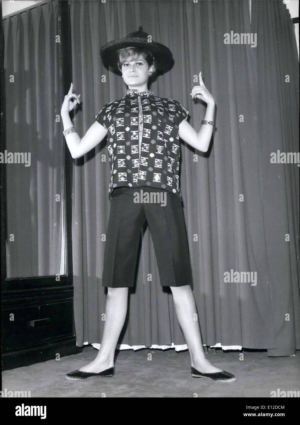 Dec. 19, 2011 - NPM- Ce Modele, intitule ''petit chinois', est concu pour recevoir des amis chez soi, ou pour regarder la telecisoin. Une courte veste en coton noir, brode de motifs multicolores, en soie. Doubleure et blouse sont en soie vert canard. Le pantelon de coolie est en shantung moir, la ceinture moire a morif argent. Le tout se porte avec un grand chapeau plat a calotte pointue, paille et satin noir, et de larges bracelets en argent massif (Lola Prussac) - Stock Image