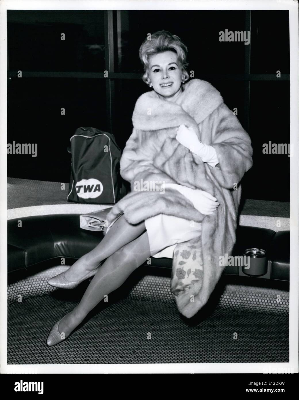 Dec. 19, 2011 - New York International Airport, Nov. 26...Seemingly ''gift-wrapped'' in a fur coat is beautiful Eva Gabor prior - Stock Image