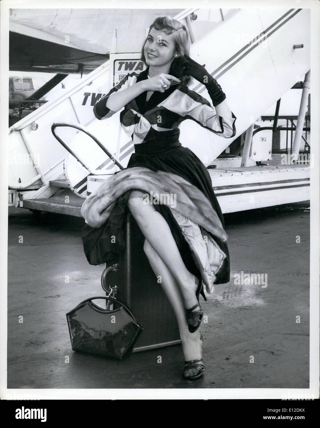 Dec. 19, 2011 - Photo From TWA Ken Fletcher, Public Relations 380 Madison Ave., New York City Oxford 5-4525 Ext 701 (For Immediate Release) La Guardia Airport, N.Y., Aug 21st - Lynn Galvin, ''Miss New York State Amvets,'' Boards a TWA Constellation at La Guardia Airport today enroute to the Amvet Convention in St. Louis. - Stock Image