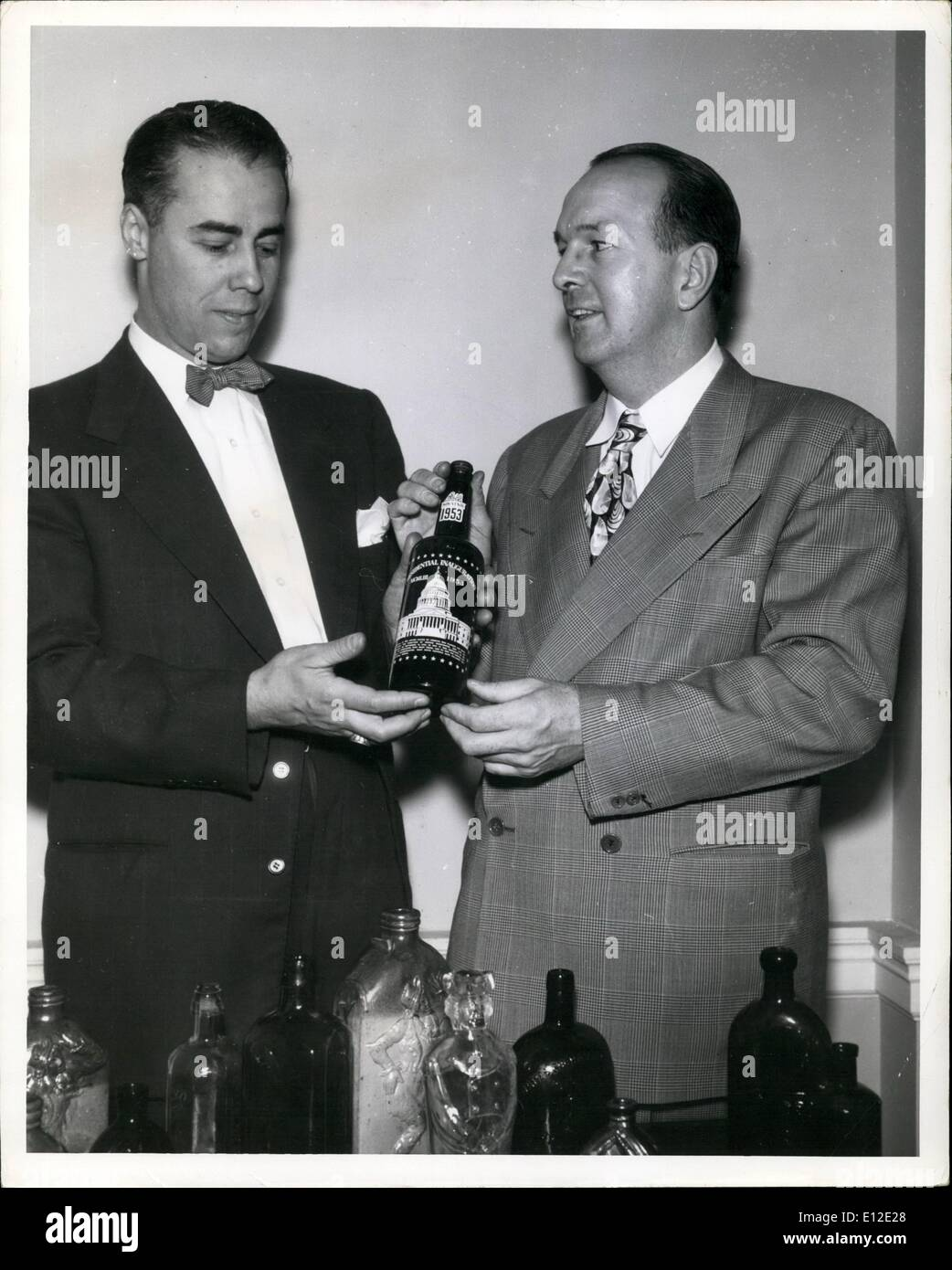 Dec. 15, 2011 - Kenneth E. Snow, director of the Cambridge Antique Show, and Milton Babcock, president of the New England Antiques Association, discuss the 1953 Souvenir Inaugural Bottle as the latest addition to the collection of antique bottles. Fused permanently into the amber bottle which commemorates the 1953 inauguration of the Dwight Eisenhower are a picture of the nation's capital and names, state, birth and inaugural dates of the nation's presidents, including Eisenhower - Stock Image