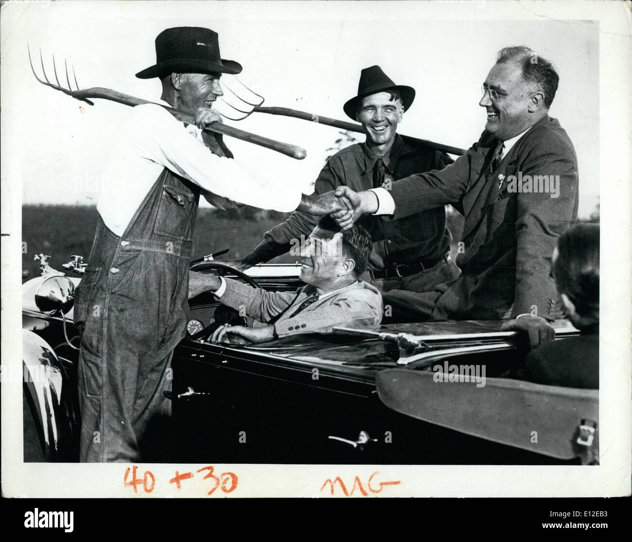 Dec. 16, 2011 - The advent of the auto caravan allowed candidates to get even closer to the people. Franklin D. Roosevelt and two Georgia farmers are all smiles at a meeting in 1932. Roosevelt, a distant cousin of Theodore, won four terms - a record. - Stock Image