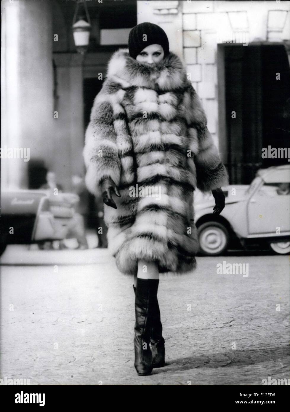 Dec. 20, 2011 - Autumn-Winter Collections 1964/65 - OPS:- A Double-Breasted Coat in Silver, Black and WHite Fox With russet lines forming as larger plaid. Created by the furrier CHOMBERIT. - Stock Image