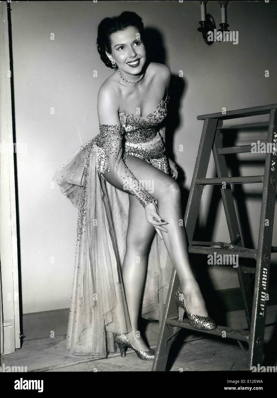 Dec. 21, 2011 - Candid Hollywood. If anyone doubts that Ann Miller has one of the most alluring figures in Hollywood, here's pictorial proof that she has. The dancing lovely is currently busy at work in a new film. - Stock Image