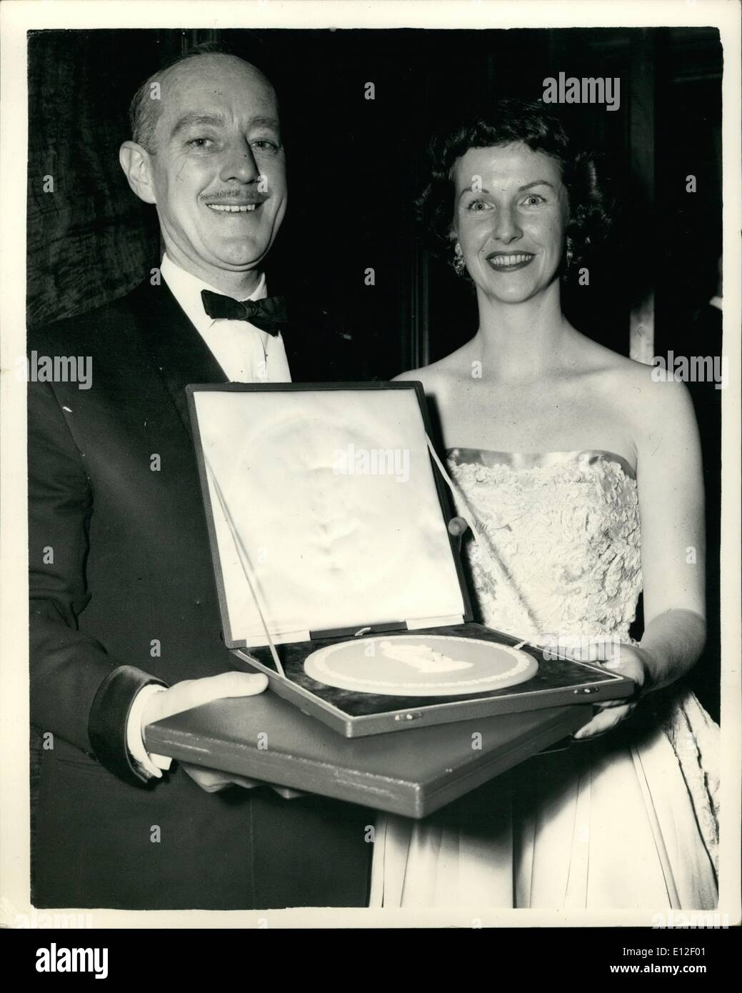 Dec. 21, 2011 - Alec Guiness, seen holding the award which he accepted on behalf of 77-year old Katie Johnson, who was elected best British actress for her performance in ''The Ladykillers'' - seen with Betsy Blair, who was elected as the best foreign actress for her role in ''Marty'' - pictured at the Odeon, this evening, after the presentations. - Stock Image