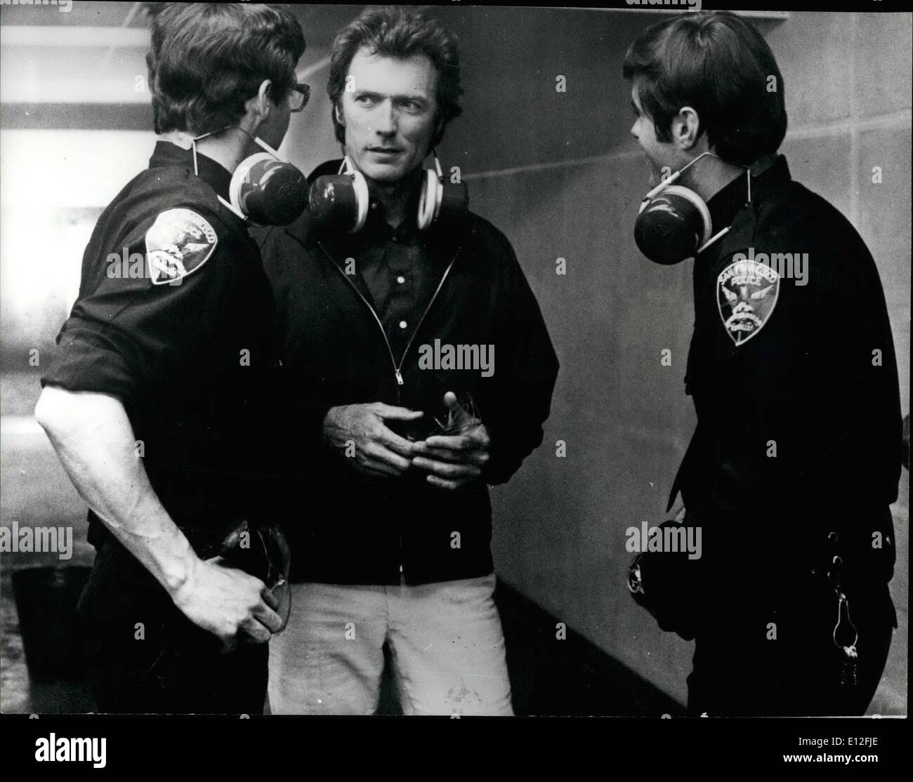 Dec. 26, 2011 - New Thriller For Clint Eastwood: Clint Eastwood has been busy making a new film thriller. Called ''Magnum Force'', the pictured described as a police shocker. It tells the story of a police force that executes its own suspects without due process of law. Clint is, of Course, one of the good guys. Photo Shows Clint Eastwood discusses his role with police in San Francisco. - Stock Image