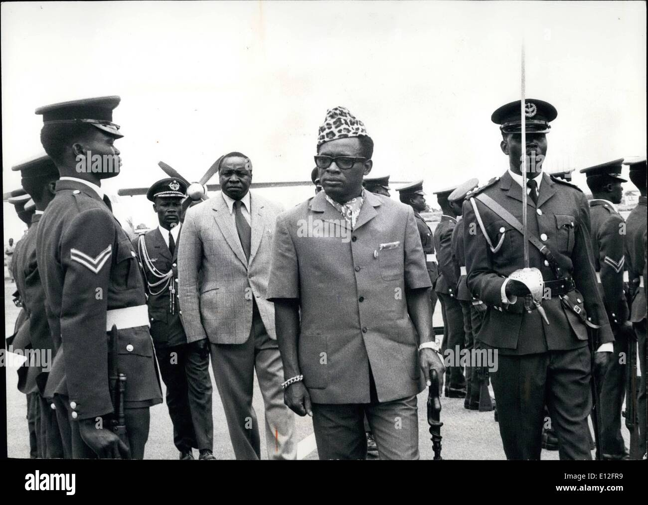Jan. 09, 2012 - During his official Visit to Uganda, President Mobutu Sese Seko of Zaire Inspects a Smart Contingent of the Uganda Air Force. Behind His Walked Unsmiling President Amin. - Stock Image